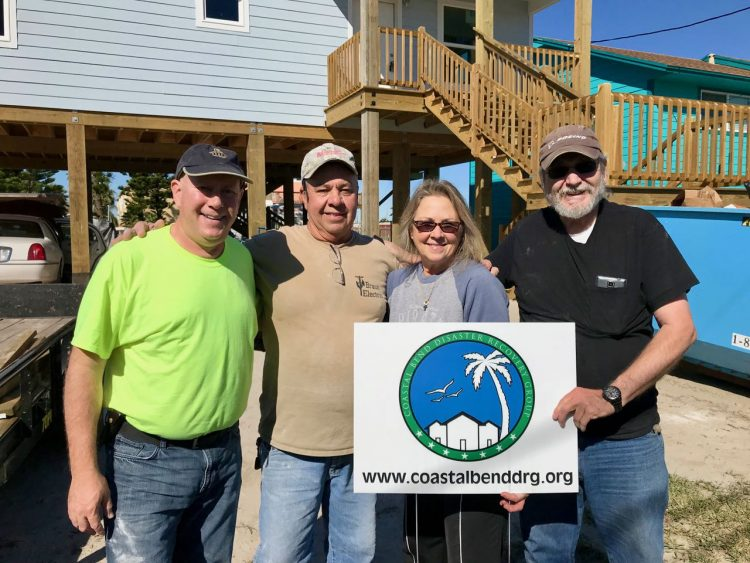 Our crew celebrating the completion of the floor installation: David, Gene (homeowner), Denise & Les (RVDC volunteers)