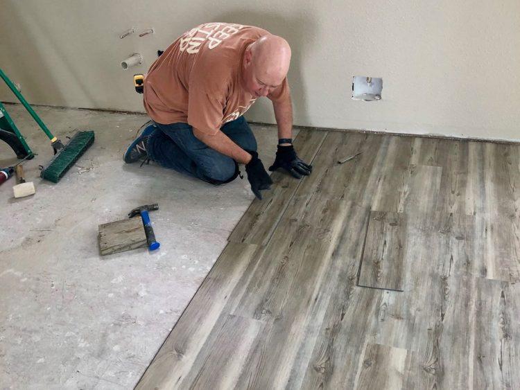 David laying flooring